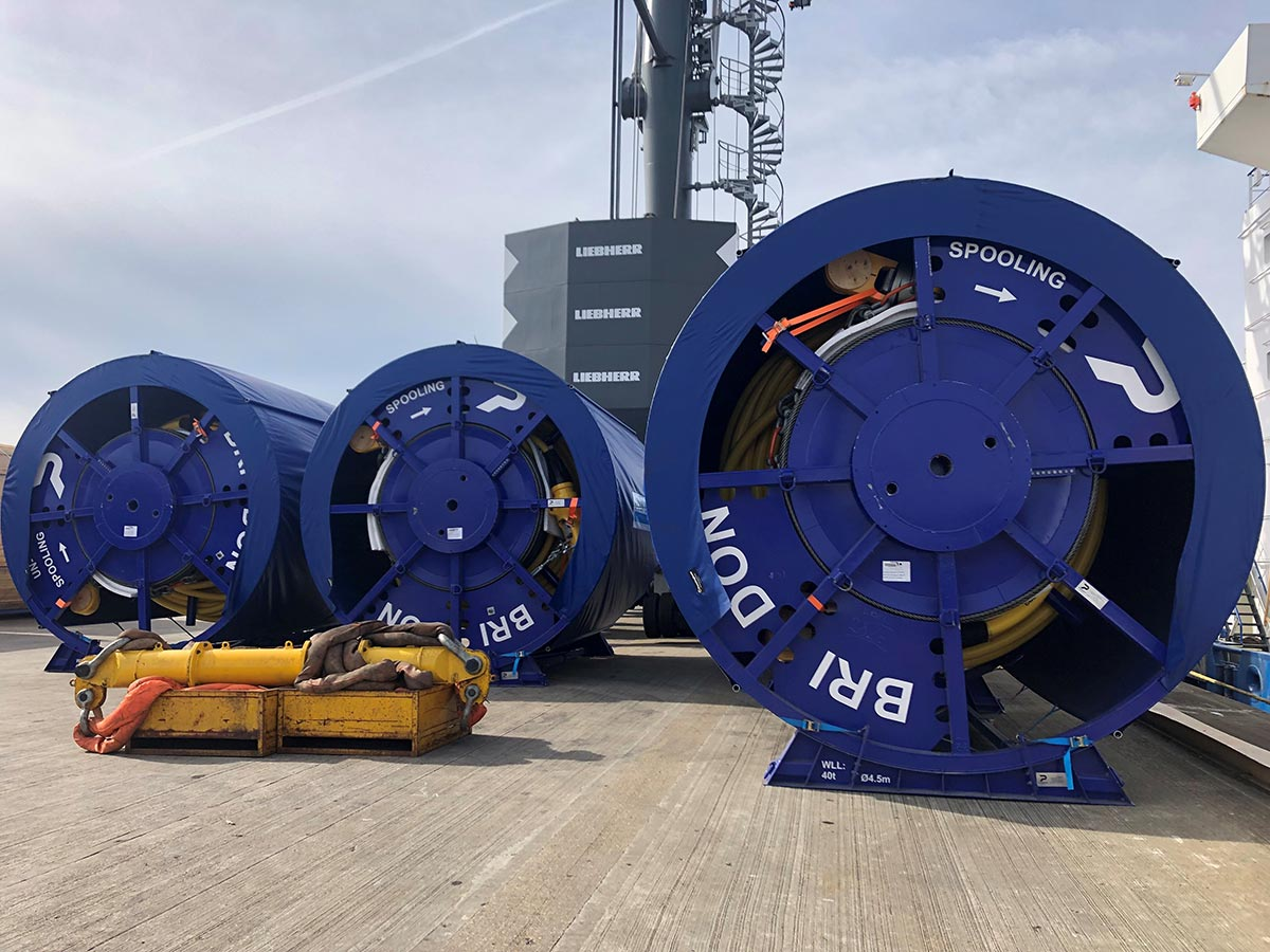 Large caable reels loaded on ship bound for the Caribbean